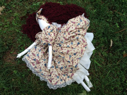 I decided to focus on a doll that the little girl may have been carrying. This is a handmade and hand-sewn doll my mom bought years ago. She it threw her in the yard (not really) so it looked like she fell.